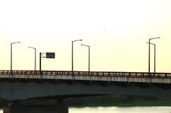 Sunset metal bridge. Metal, rusty bridge, shot at dusk with no cars royalty free stock images
