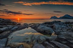 Sunset at midnight. Lofoten is known for excellent fishing, spectacular nature attractions such as the northern lights and the midnight sun, and small villages Stock Photo