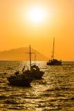 Sunset on Milos island, Greece. Fishing boats and beautiful sunset near Klima village on Milos island, Greece Stock Image