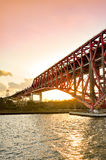 Sunset at the Minato Bridge red bridge in Osaka crossing over Royalty Free Stock Photo