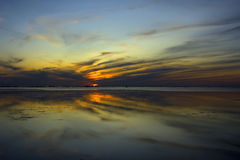 Sunset mirror. Mirrored sunset at baltic sea in place close to Tallinn Royalty Free Stock Image