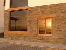 Sunset mirrored in windows at Pulpos resort Stock Photos