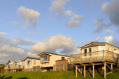 Sunset on mobile houses in st Audries bay, Somerset. View of a line of holiday cottages at seaside shot in the light of sunset stock photos