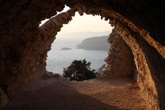 Sunset at Monolithos Castle. View on the see from the ruins of Monolithos Castle, Rhodes, Greece Royalty Free Stock Photos