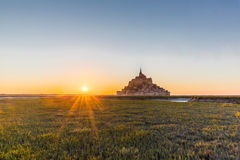 Sunset at Mont Saint Michel in France stock photography