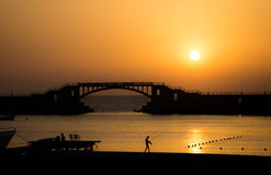 Sunset in Montaza , Alexandria , Egypt. Landscape of the sunset at Montaza beach , in Alexandria - Egypt , showing Montaza bridge , with a man who is fishing stock photography