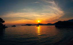 Sunset in Montenegro over the mountains and the sea. Orange sunsets Royalty Free Stock Photo