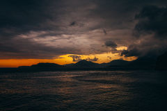 Sunset in Montenegro over the mountains and the sea. Orange sunsets Royalty Free Stock Photography