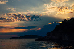 Sunset in Montenegro over the mountains and the sea. Orange sunsets Stock Images