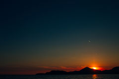 Sunset in Montenegro over the mountains and the sea. Orange sunsets Stock Photos