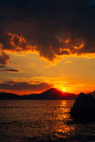 Sunset in Montenegro over the mountains and the sea. Orange sunsets Royalty Free Stock Image