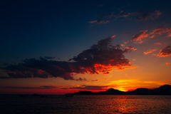 Sunset in Montenegro over the mountains and the sea. Orange sunsets Stock Photo