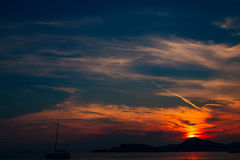 Sunset in Montenegro over the mountains and the sea. Orange sunsets Stock Image