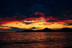 Sunset in Montenegro over the mountains and the sea. Orange sunsets Royalty Free Stock Images