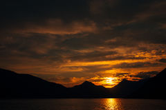 Sunset in Montenegro over the mountains and the sea. Orange sunsets Royalty Free Stock Photos
