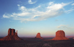 Sunset in Monument Valley. With three butes and cloud Stock Photo