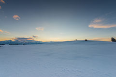 Sunset mood at snow meadow Royalty Free Stock Images