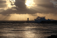 Sunset moody seascape with sunbeams Stock Images