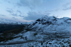 Sunset and a moon in Alps Royalty Free Stock Photography