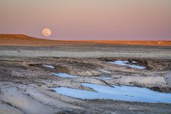 Sunset and moon rise over prairie royalty free stock images