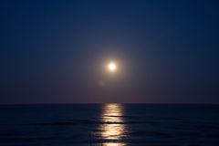 Sunset and the moon rising on the Mediterranean coast in southern Spain Royalty Free Stock Photos