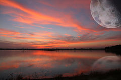 Sunset with moon Stock Photography