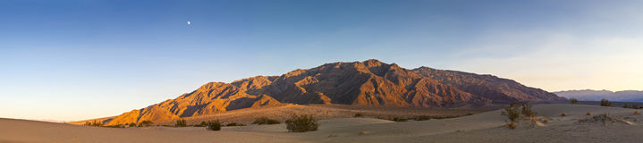Sunset and Moonrise over Death Valley mountains Stock Photos