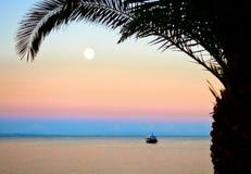 Sunset and Moonrise Stock Photos