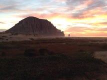 Sunset at Morro Rock. Morro Bay, California Stock Photos