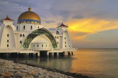 Sunset at the mosque. A photo taken during a sunset at the Masjid Selat mosque in Malaysia Stock Photo