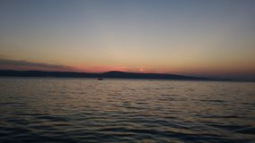 The sunset is most beautiful from the boat royalty free stock photography