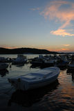 Sunset and motor boats in Mali Losinj harbour,Croatia. Sunset in Mali Losinj harbour with the fishing motorboats Stock Photo