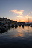 Sunset and motor boats in Mali Losinj marina,Croatia Stock Photos