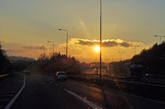 Sunset on the motorway in the British countryside. Royalty Free Stock Photo