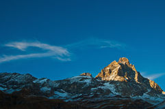 Sunset on Mount Cervino, Aosta Valley. Last rays of sun on the Matterhorn in an autumn sunset royalty free stock photos