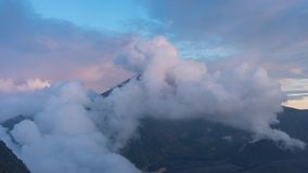 Sunset at Mount Rinjani Volcano on Lombok Indonesia 4K time-lapse with clouds passing by stock footage