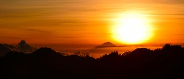 Sunset from mount Rinjani, wtih a view of mount Agung volcano Stock Images