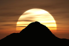 The sunset mountain. A mountain shape with sunset on the background stock photography