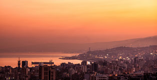 Sunset on mountain city. Beautiful red sunset on mountain city, evening cityscape, mediterranean sea, travel and tourism concept Stock Photo