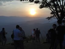Sunset at the mountain. Crowd wait, see and take photo at sunset Stock Photography