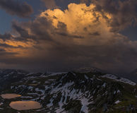 Sunset in mountain. Dramatic overcast sky. Caucasus mountains Royalty Free Stock Photos