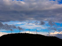 Sunset mountain with electric windmills Royalty Free Stock Photos
