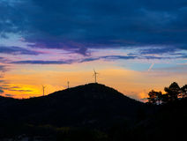 Sunset mountain with electric windmills Stock Image