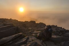 Sunset in mountain. Knapsack and stones in sunset royalty free stock photos