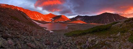 Sunset Mountain Lake. Two-row view of the sunset on a mountain lake Stock Image