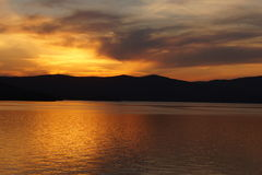 Sunset at the mountain lake. Beautiful sunset at the mountain lake Royalty Free Stock Images