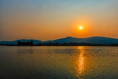 Sunset on mountain lake in Chiang Rai,North of Thailand Royalty Free Stock Photo