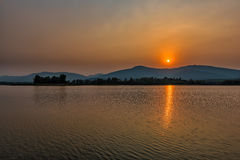 Sunset on mountain lake in Chiang Rai,North of Thailand Royalty Free Stock Photos