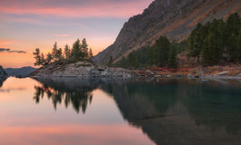 Sunset Mountain Lake With Pink Calm Waters, Altai Mountains Highland Nature Autumn Landscape Photo Royalty Free Stock Images