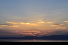 Sunset on mountain lake. Summer sunset on mountain lake Son-Kul in the Tien Shan, Kyrgyzstan Royalty Free Stock Photos
